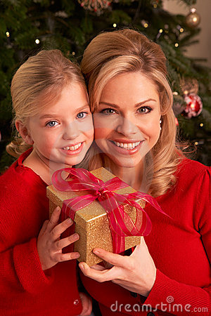 Daughter Giving Mother Christmas Gift