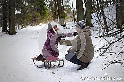 Daughter hug fatgher outdoors winter
