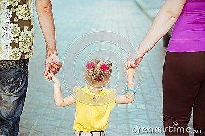 Daughter keeping her parents hands