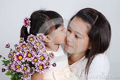Daughter kiss her mother