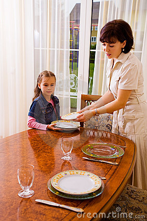 Daughter And Mom Setting The Table Stock Photos Image
