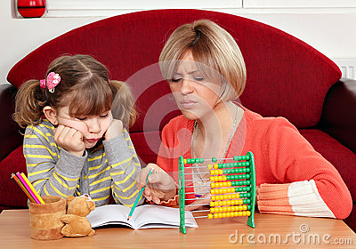 Daughter and mother doing homework
