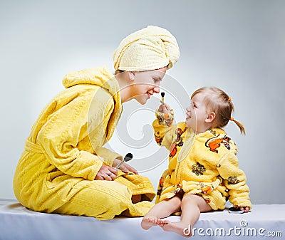 Daughter and mother putting makeup