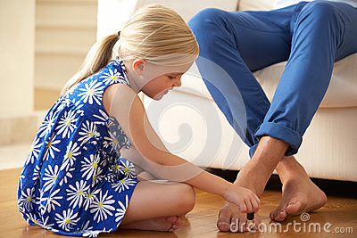 Daughter Painting Father s Toenails At Home