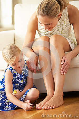 Daughter Painting Mother s Toenails At Home