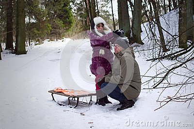 Daughter playing with father in winter