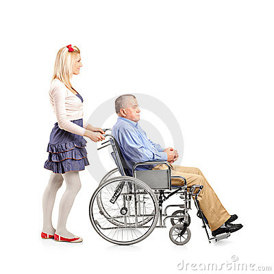 Daughter pushing her dad in a wheelchair