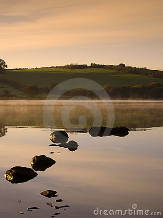 Dawn on a Misty Lake