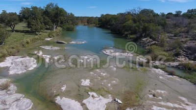 Day aerial flyover creek in Oklahoma. A daytime aerial flyover establishing shot of a creek in Oklahoma stock footage