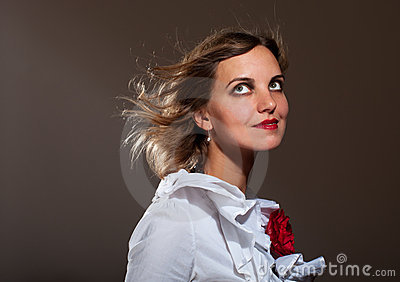 Daydreamed woman in white blouse