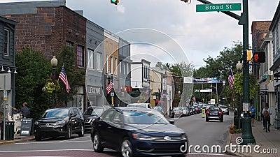 Daytime Establishing Shot Business District on Main Street USA. 9187 SEWICKLEY, PA - Circa September, 2017 - A daytime establishing shot of the business district stock video