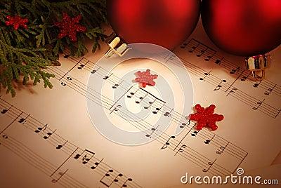De achtergrond van Kerstmis met bladmuziek