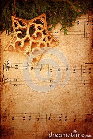 De achtergrond van Kerstmis met oude bladmuziek