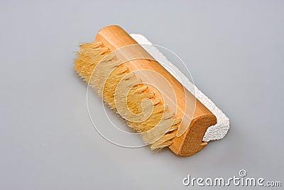 De borstel van de spijker en puimsteen