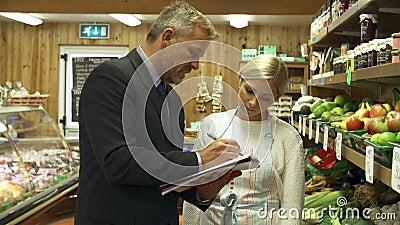 De Eigenaar van Bankdirecteurmeeting with female van Landbouwbedrijfwinkel
