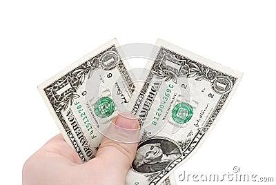 De hand houdt twee dollars