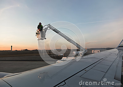 De-Icing an Airplane Editorial Stock Image