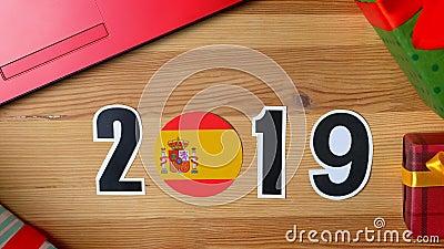 De illustratie, nieuw jaar, mannelijke hand zette op de lijst aangaande Spaanse vlag, de bal van het land, 2019 stock footage