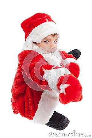 De jongen kleedde zich als Kerstman, isolatie