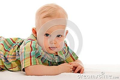 De jongen van de baby op de deken