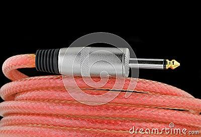 De kabel van de gitaar