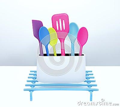 De kleurrijke hulpmiddelen van het keukenwerktuig