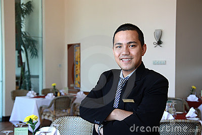 De manager van het restaurant op het werk