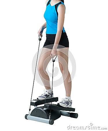 De oefening van de vrouw met stepper machine
