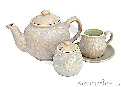 De pot van de thee met kop en melkkruik