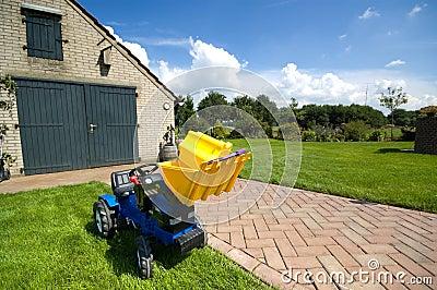 De tractor van het stuk speelgoed