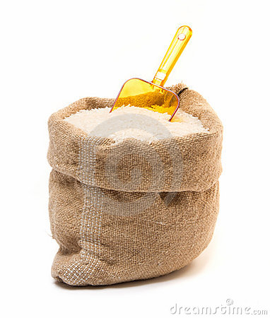 De zak van de rijst en transparante plastic lepel