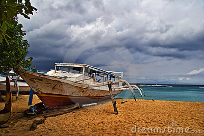 Dead boat on the beach