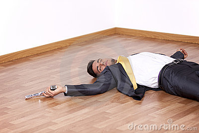 Dead businessman in the floor