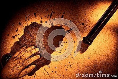 Dead Man Hand with Blood Splatter and Murder Gun