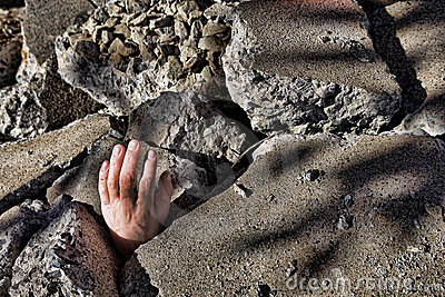 Dead Man Hand in Rubble after Earthquake Disaster
