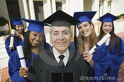 Dean and graduates outside university