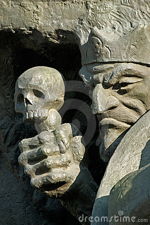 Death and skull-fragment of a sculpture