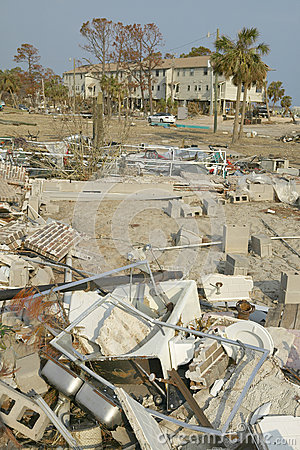 Debris in front of houses heavily hit by Hurricane Editorial Stock Image