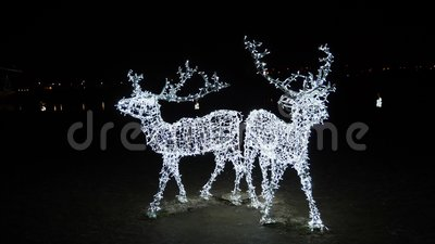 December in Kaunas, Lithuania. Christmas atmosphere of the city at night. Illuminanited deers in front of Kaunas castle. December in Kaunas, Lithuania. Christmas stock video footage