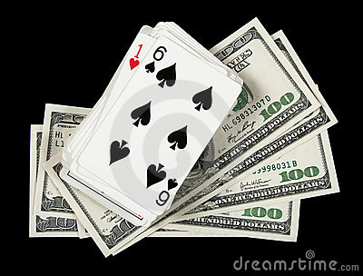 Deck of cards and money on black background