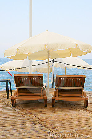 Deck-chair against the sea and sky.