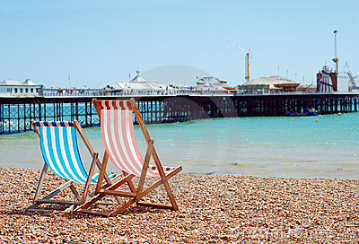 Deck chairs on the beach Brighton England