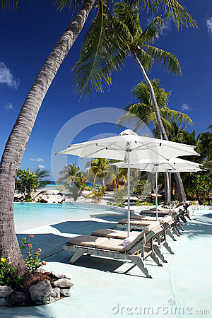 Free Deck Chairs By The Swimming Pool In Tropical Resort In French Polynesia Royalty Free Stock Photos - 42337178