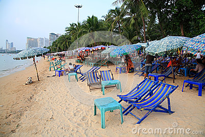 Deck chairs to sightseeing and eating at the beach Editorial Stock Image