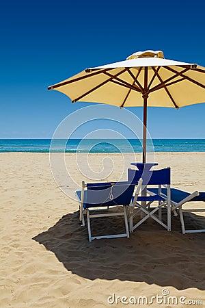 Deck chairs under an umbrella