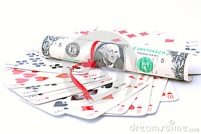 A deck of playing cards and one dollar bill