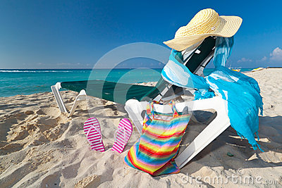 Deckchair with sun accessories on the Caribbean be