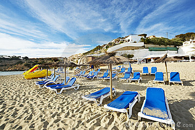 Deckchair and sunshade on a beach of ibiza