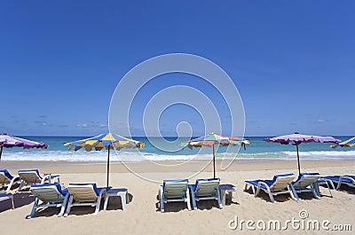 Deckchairs on beach