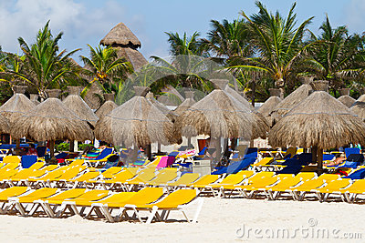 Deckchairs with parasols at Caribbean Sea
